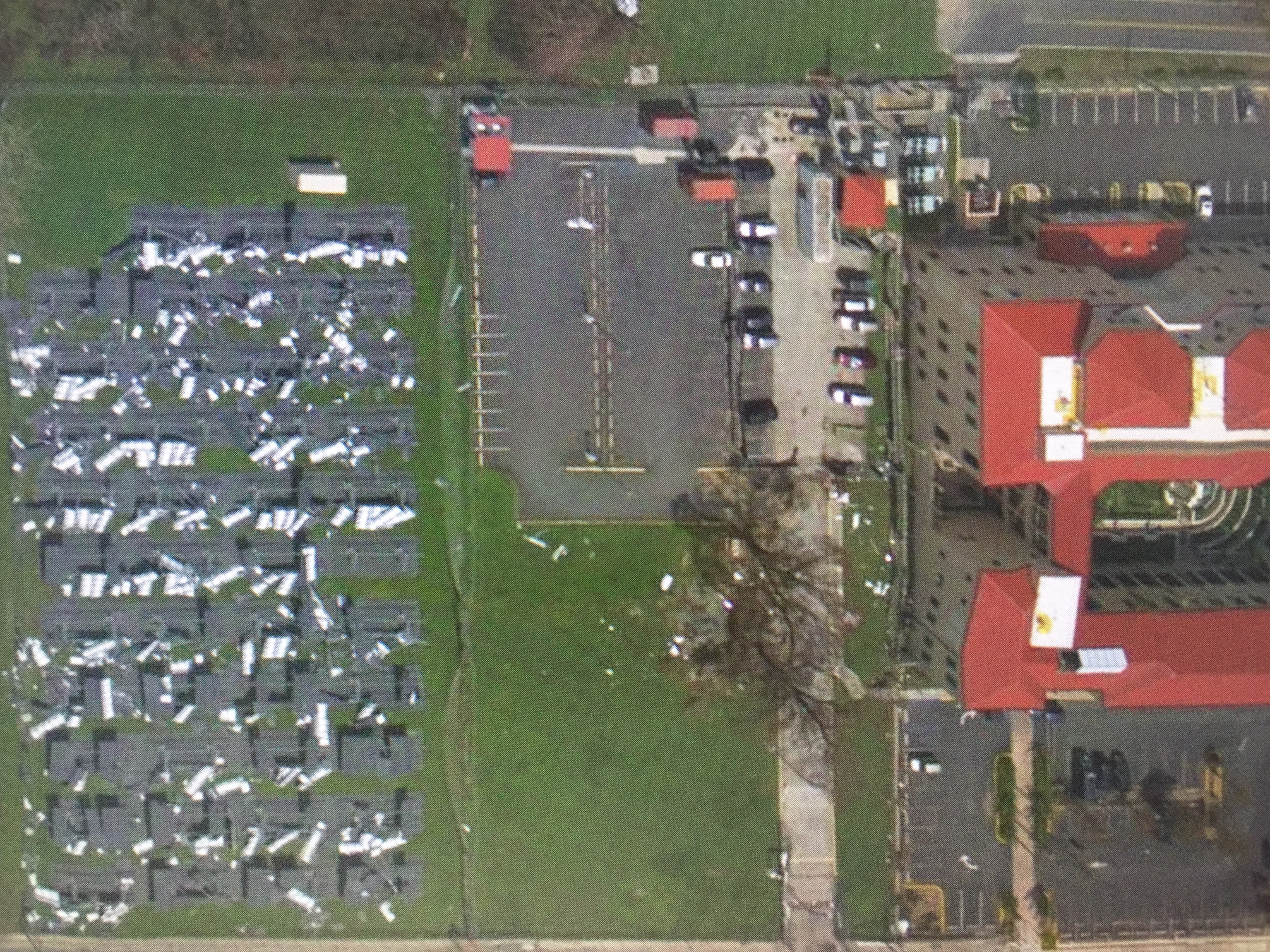 A Post Hurricane Image Of The Federal Courthouse In St. Croix (on Right  With Red Roof) And The Courthouseu0027s Solar Panel Field (left).